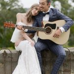 Groom plays music on his guitar to his bride