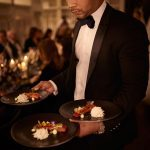 Waiters in tuxedos and black velvet bowties