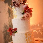 White wedding cake with gold foil accents