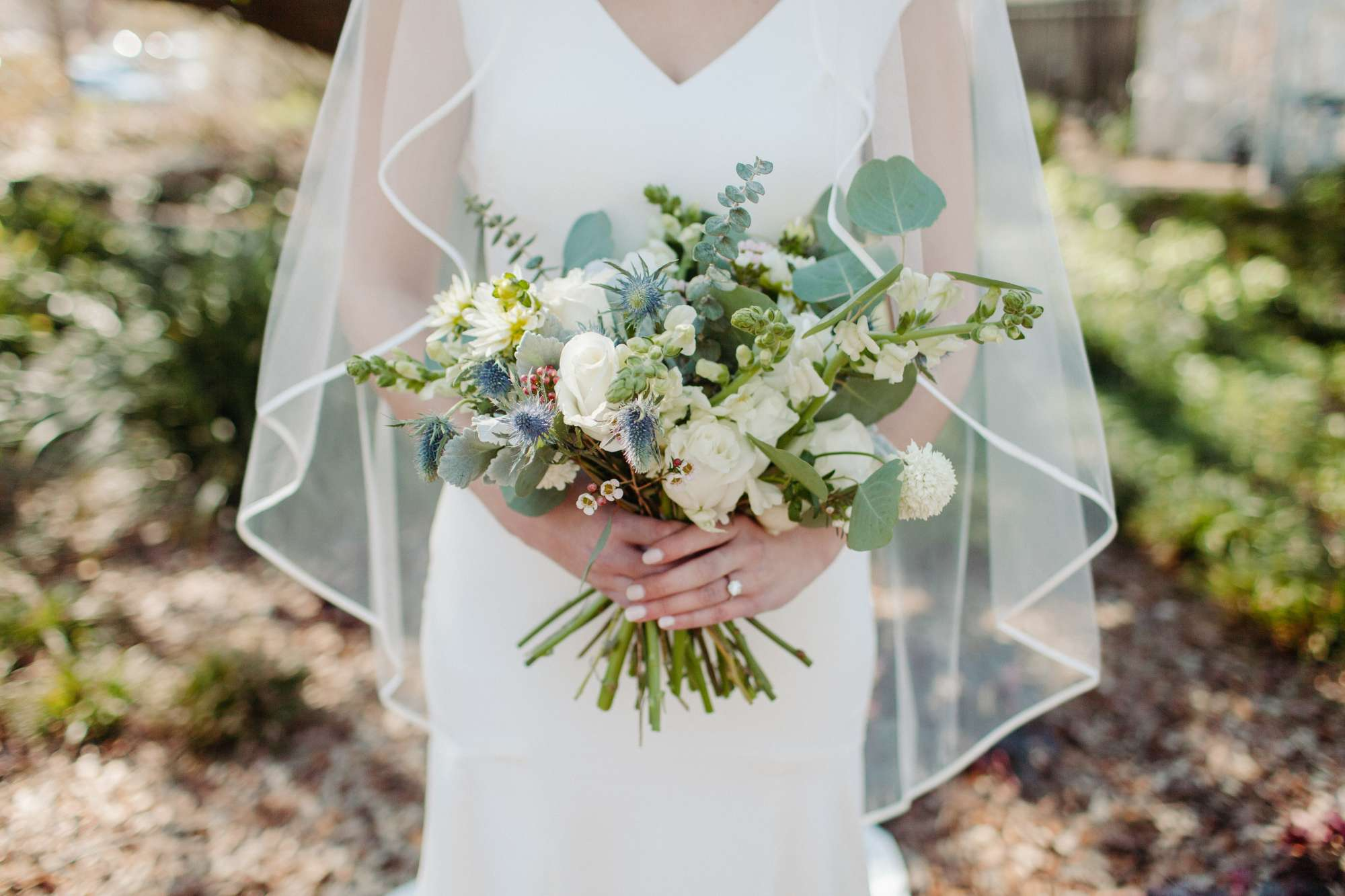 Bride Holding Boquet of Flowers